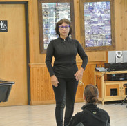 Janice teaching in front of a class