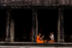 Canva - Woman Sitting in Front of Monk.j