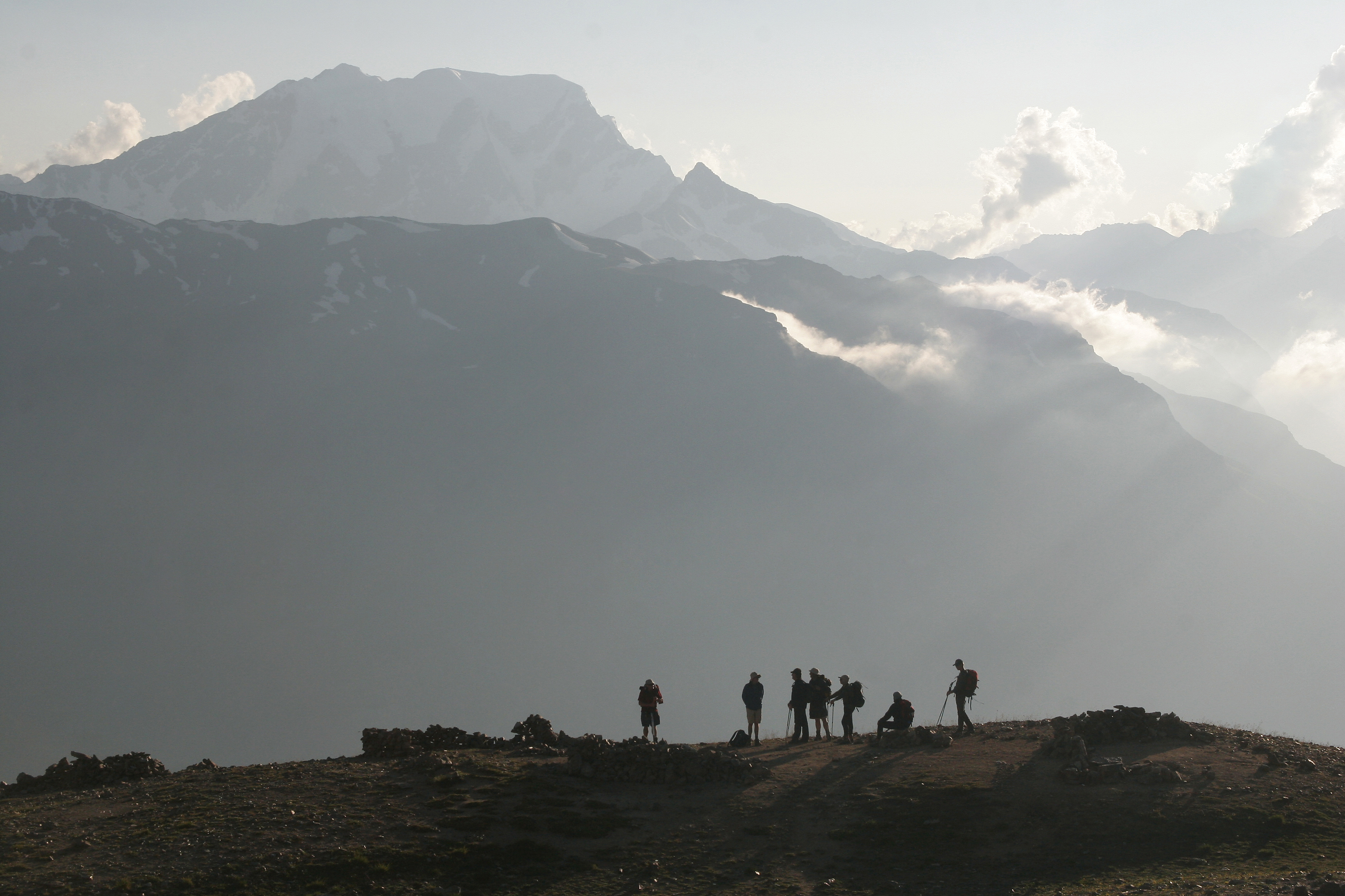 Trekking group has a rest in the sunset time in a mountain pass.jpg