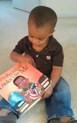 Aiden enjoying his book!