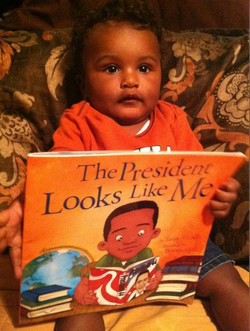 Tanner LOVES his first book.