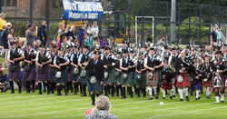 Massed pipe bands at the Brodick Highland Games, 6th August 2016