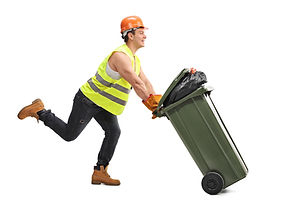 Excited young waste collector pushing a trash can and running isolated on white background.jpg