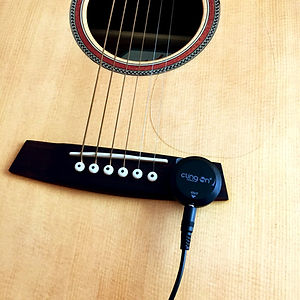 Cling On Pickup attached to bridge of  guitar