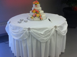 Cake Table w/Pillowed Tablecloth Skirting Accent