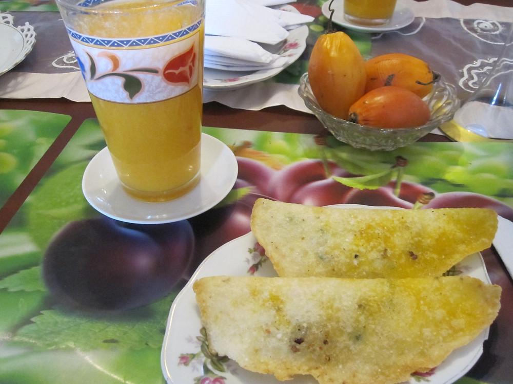 Ecuadorian empanadas and tomato juice