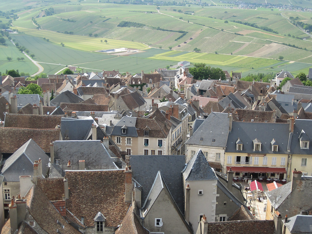 Somewhere in that square, sits an old gentleman… (Sancerre, France)