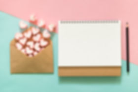 Blank notepad with pink marshmallows in