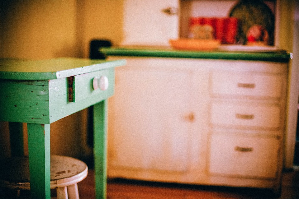 farmouse kitchen with fresh green distressed table