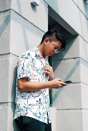 Young adult male looking at phone
