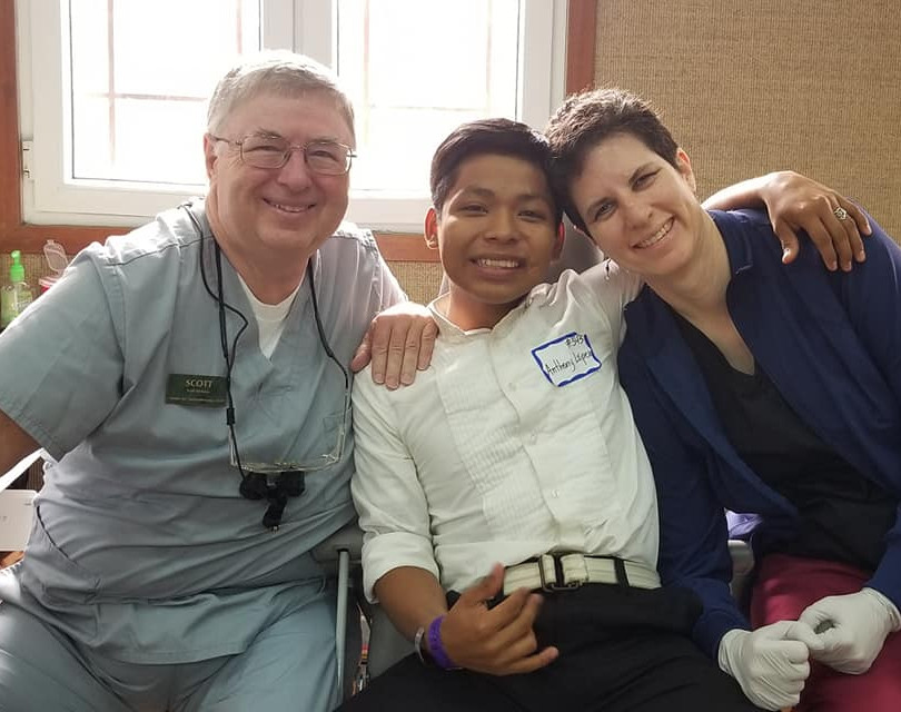 Dr. Dickson and his wife with a patient in Central America