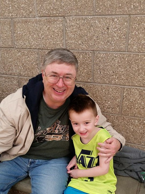 Dr. Dickson supporting his Grandson at his Junior Jazz game
