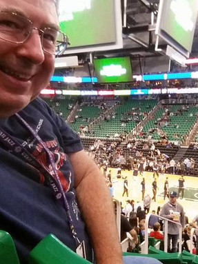 Dr. Dickson and his Grandson at a Jazz Game