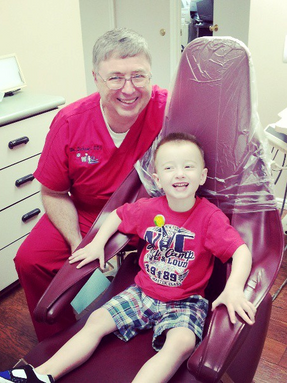 Dr. Dickson with a happy patient!