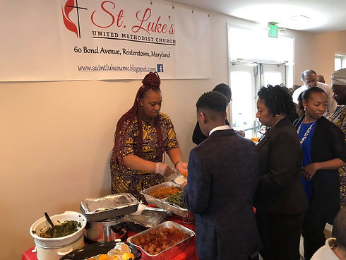 serving food at st lukes.jpg