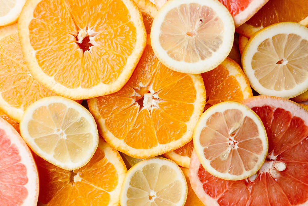 All sorts of citrus sliced in circles
