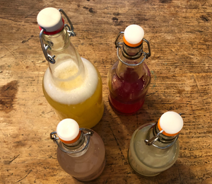 Four bubbly flip top bottles of kefir