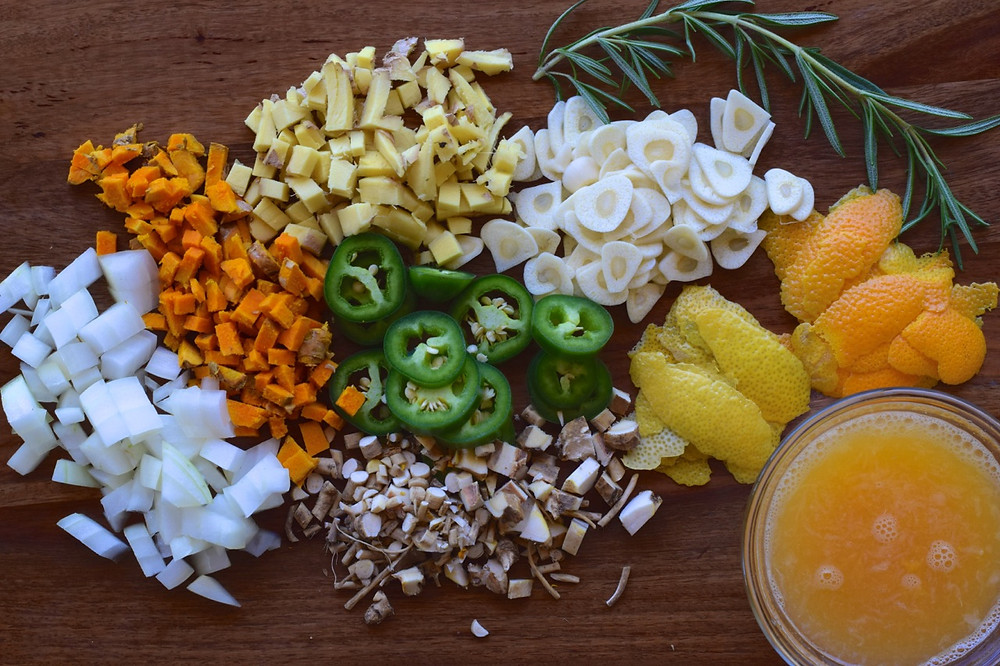 Onions, turmeric, ginger, garlic, jalapeños, citrus and herbs for fire cider