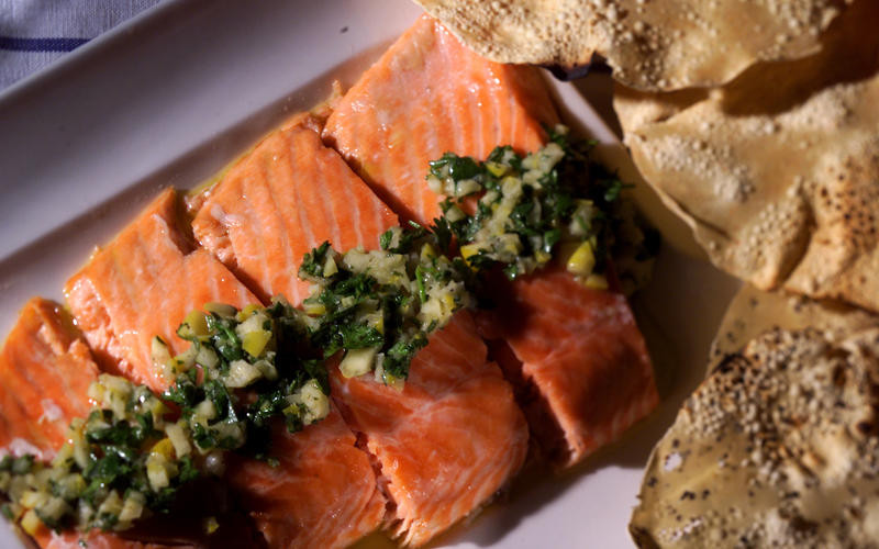Baked salmon dressed with preserved lemon relish