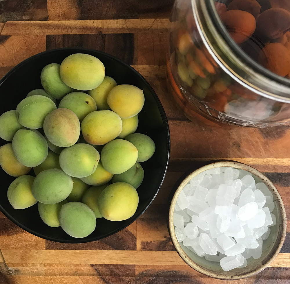 Unripe plums, rock sugar and a jar