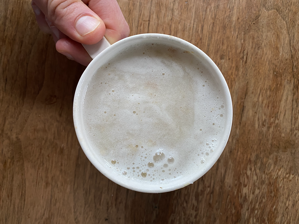 A cup of amazake blended with water as a warm milk alternative