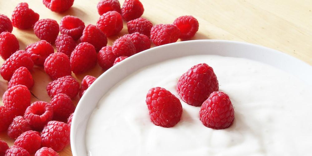 Bowl of homemade yogurt with fresh raspberries