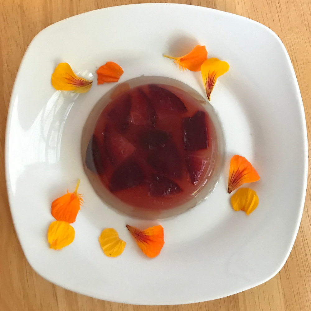 Kanten with fruits and edible flowers