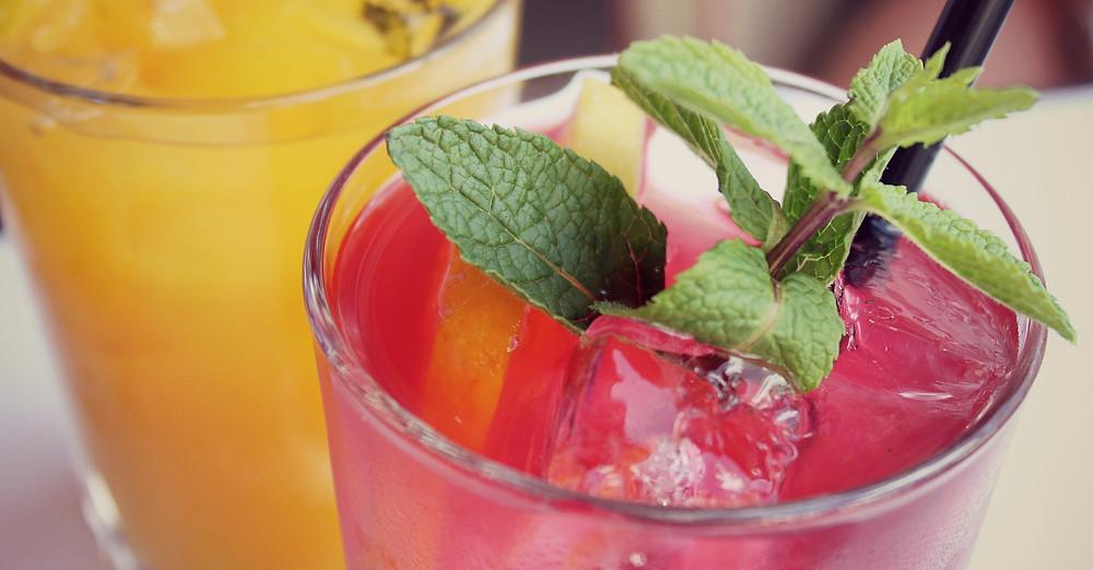 Glass of hibiscus kombucha with mint garnish