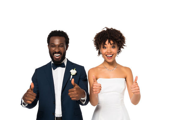 young New York City bride and groom giving a thumbs up!