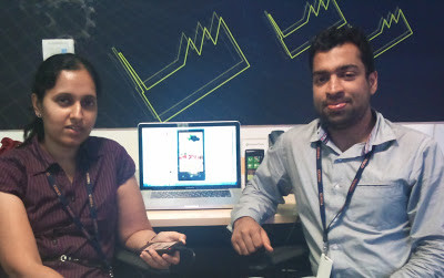 photo of Rangeetha Rao and Rajiv Agarwal sat next to their development environment PC showing Windows 7 Phone Tesco groceries implementation.