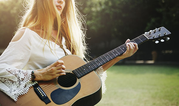 Blonde Girl Playing Guitar In The Park C