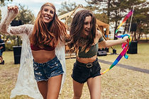 Hipster girls having fun at music festiv