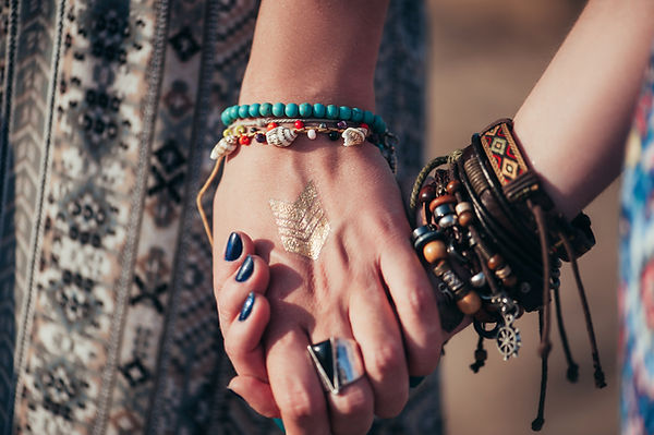 close up hands with boho accessories..jp