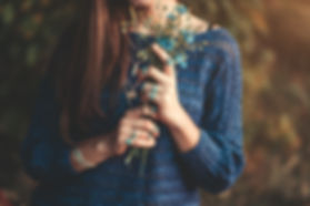 Boho chic woman in knitted blue sweater