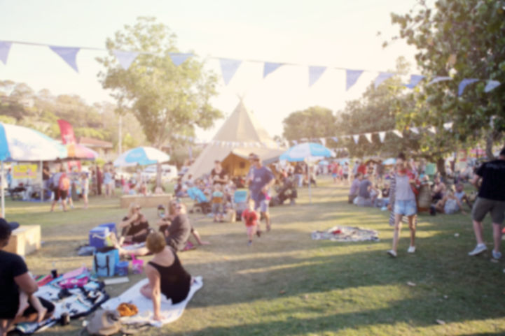 Blur defocused background of people, family in park fair, festive summer, music festival t