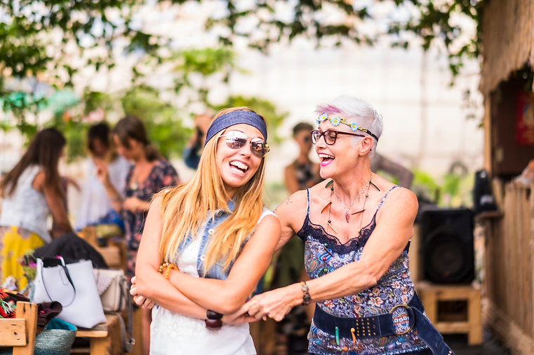 happy friendship couple of woman young and mature ladies with hippy clothes and dress have