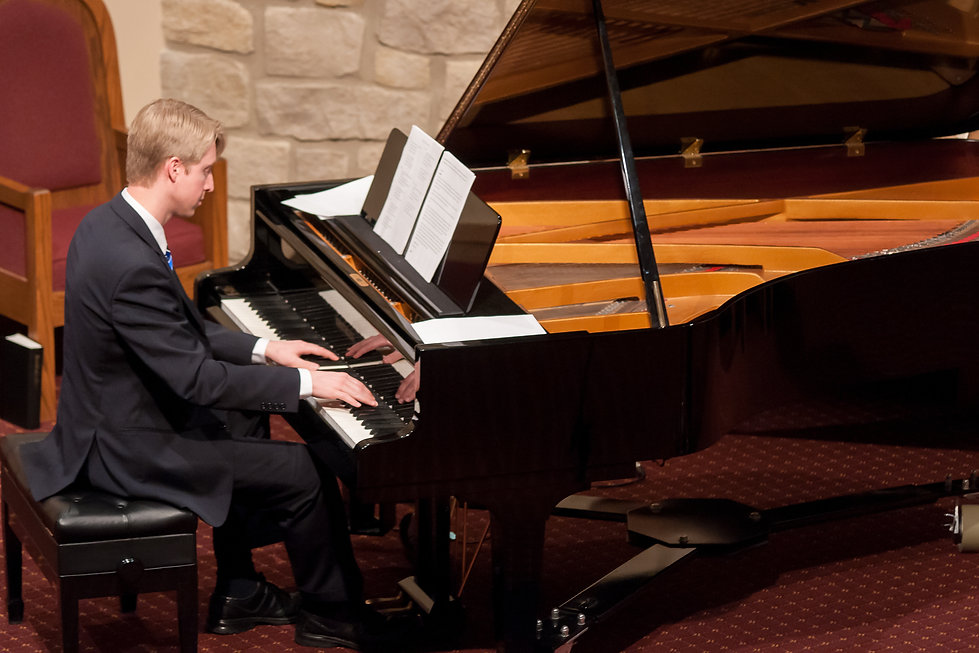 Dave Colburn playing piano at Centerville concert