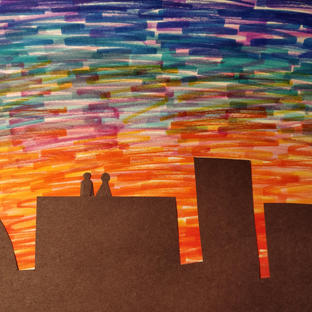 silhouette of 2 people looking over a sunset!