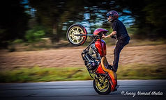 sports photographer daytona beach, action photographer daytona beach, surf photography daytona beach, moto photo, wheelie, sport videographer daytona beach, commercial photography daytona beach, bike week photographer daytona beach, motorcycle stunt, pop a wheelie