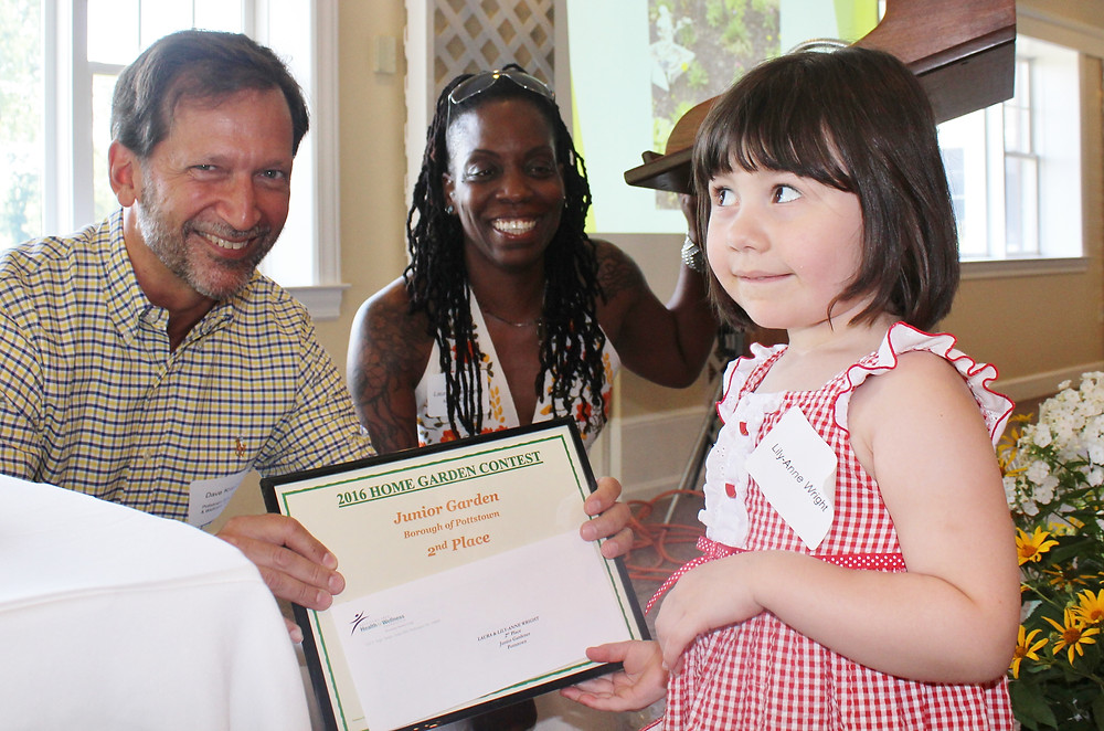 Lily-Anne Wright, 4, receives the second place award for the 2016 Home Garden Contest junior category from Dave Kraybill, Pottstown Area Health & Wellness Foundation executive director, and Laura Washington, Pottstown community garden manager. Contest organizers had an awards ceremony Sunday afternoon at the Brookside Country Club in Pottstown.