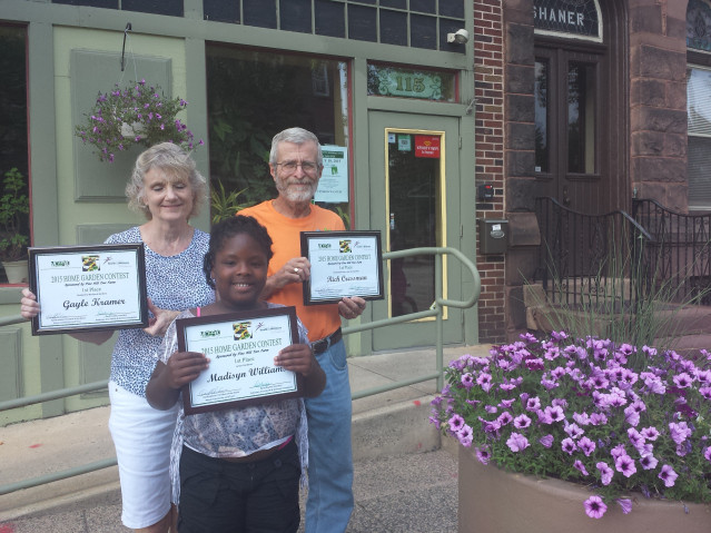 From left to right: Gayle Kramer, Rich Cressman and Madisyn Williams were first place winners for the 2015 Home Garden Contest. Winners took home cash prizes for their efforts.
