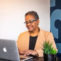 Agent Marilyn Ellis works on her laptop at our Melrose Office