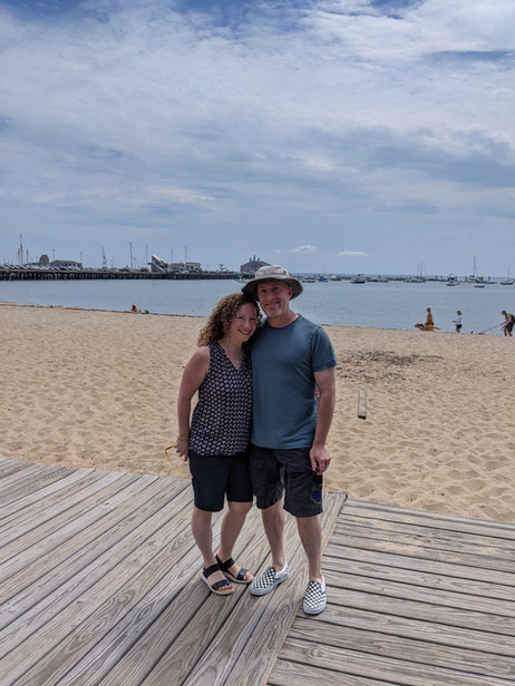 Amy and her husband at the beach