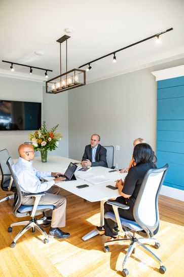 Agents meet in the Andover conference room