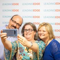Agents Aldo Masciave, Virginia Todd and Patti Nardone pose for a selfie