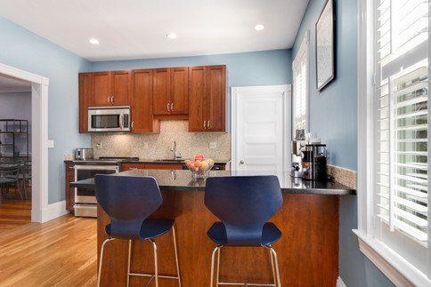 Kitchen with brown cabinets and peninsula