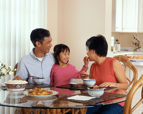 Asian family enjoying dinner together