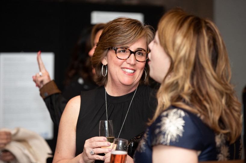 Agent, Kim Perrotti socializes at an event