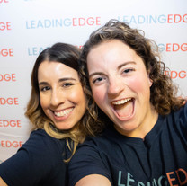 Staff members Amanda and Becca take a selfie at the brand reveal