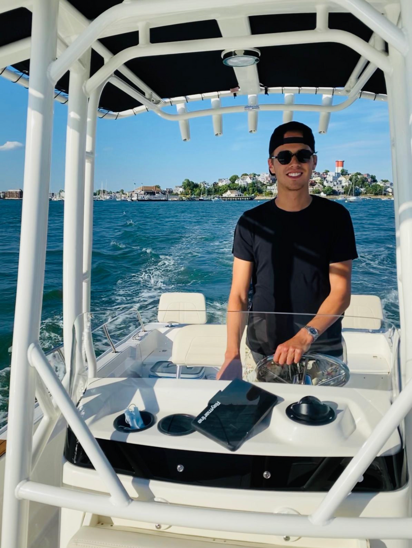 Sam driving the boat